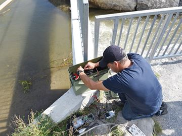 Christopher Bunt, CEO of Biotactic Fish and Wildlife Research, tested a camera system to record data for counting and identifying fish moving through the Bowmanville fish ladder. September 24, 2015.